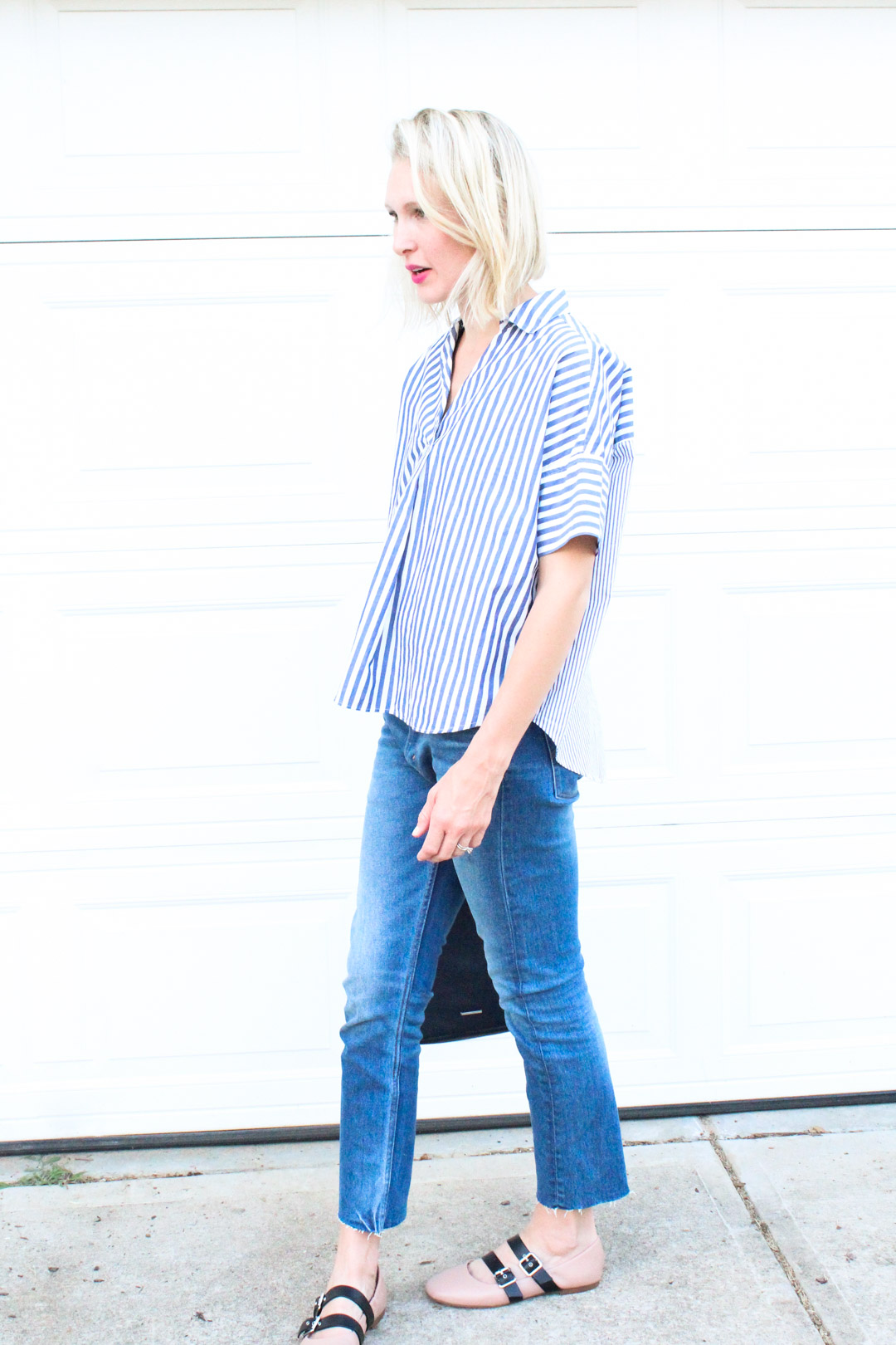 blue striped top and cropped jeans
