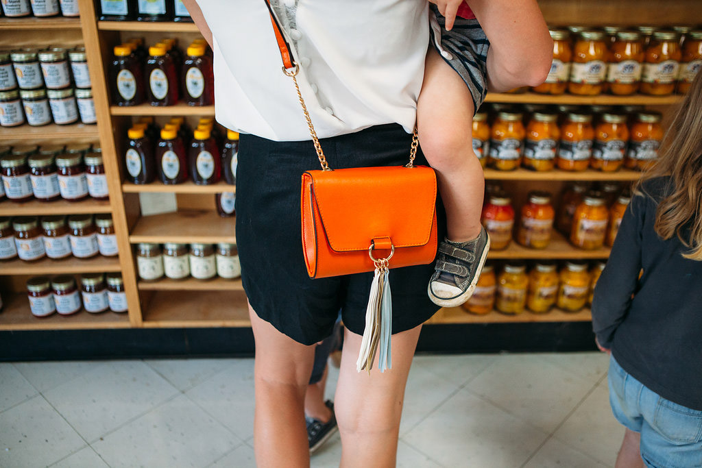 orange-tassel-crossbody-bag