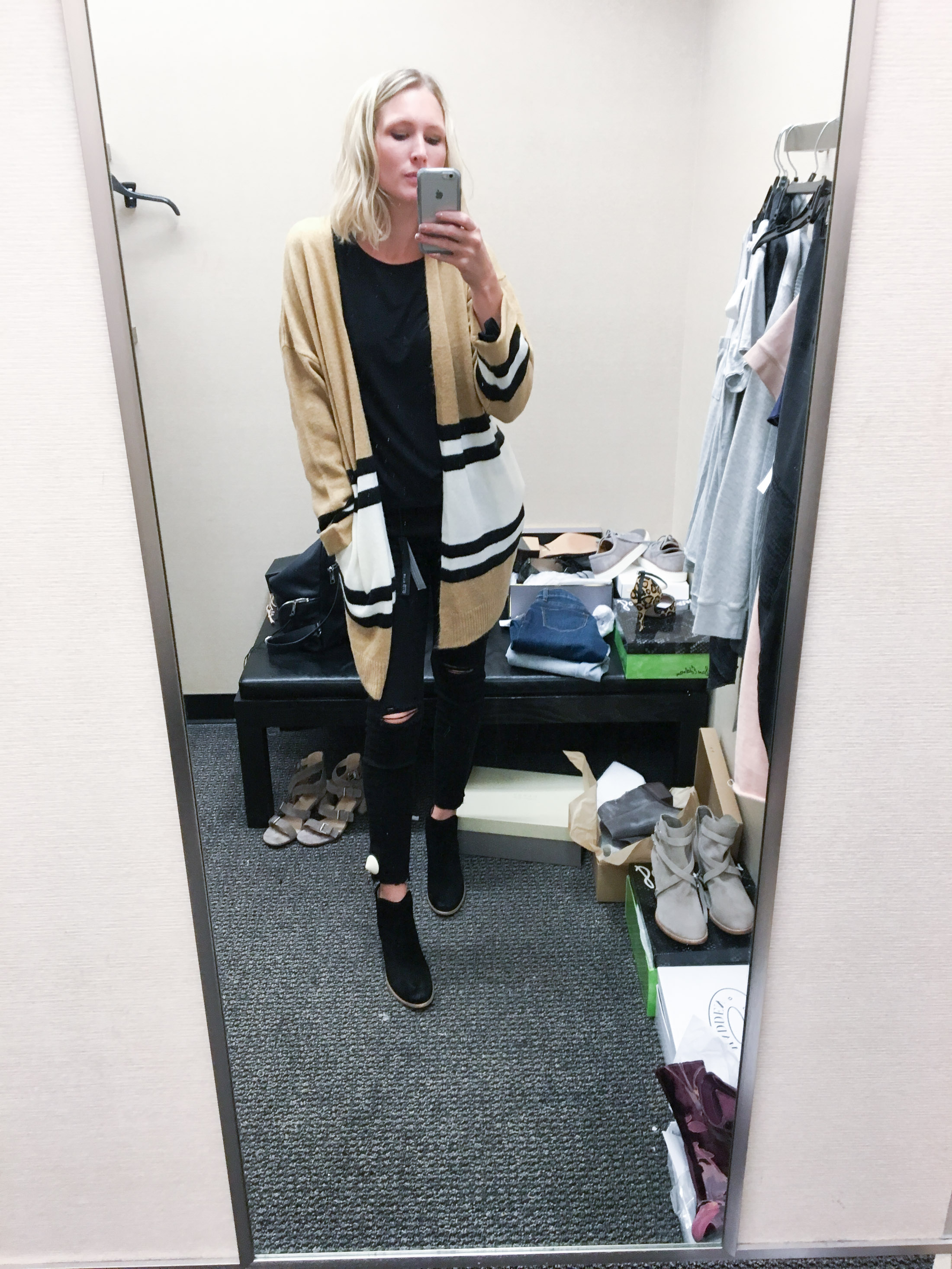 black outfit with long striped cardigan