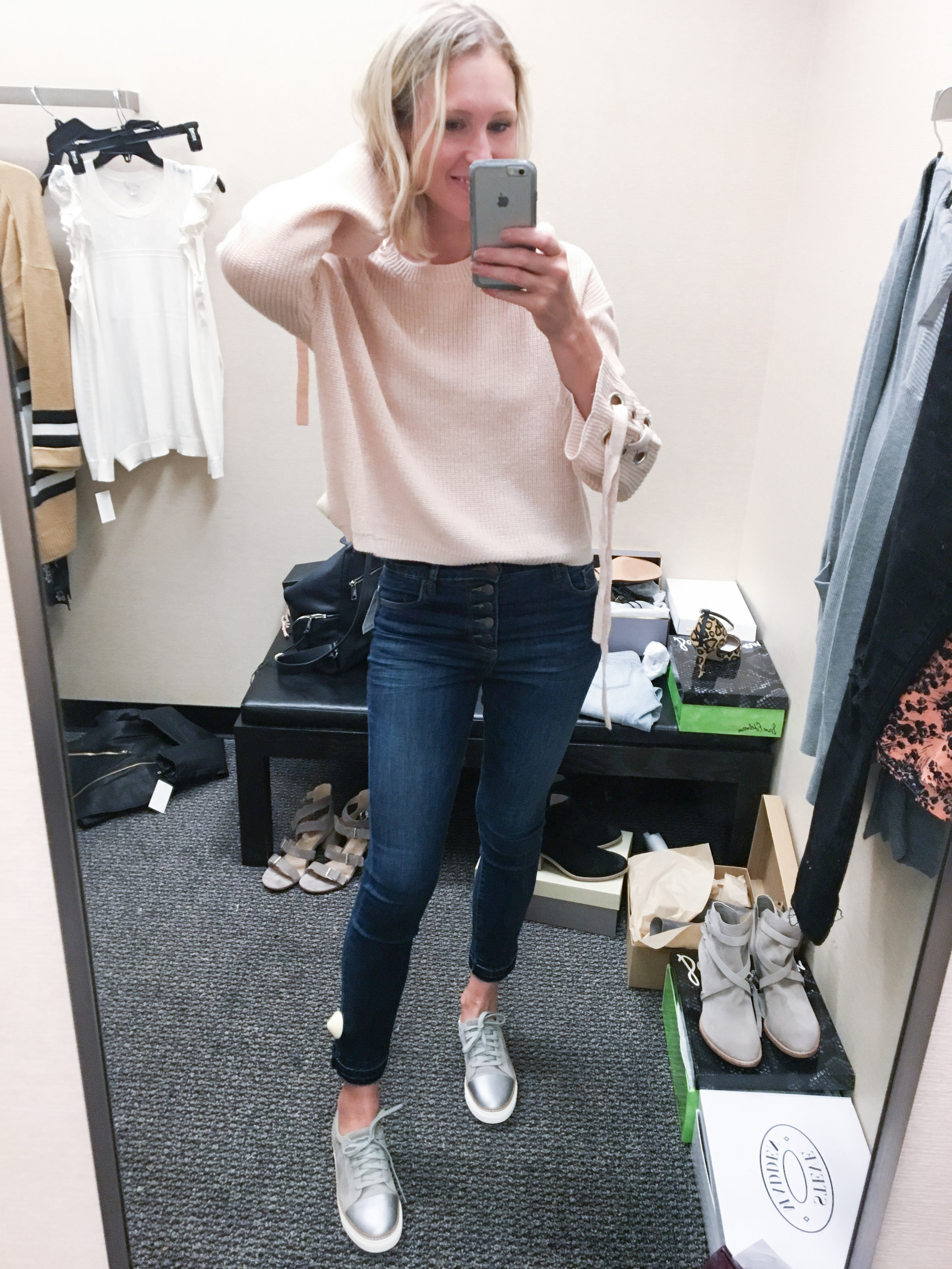 pullover pink sweater with silver sneakers