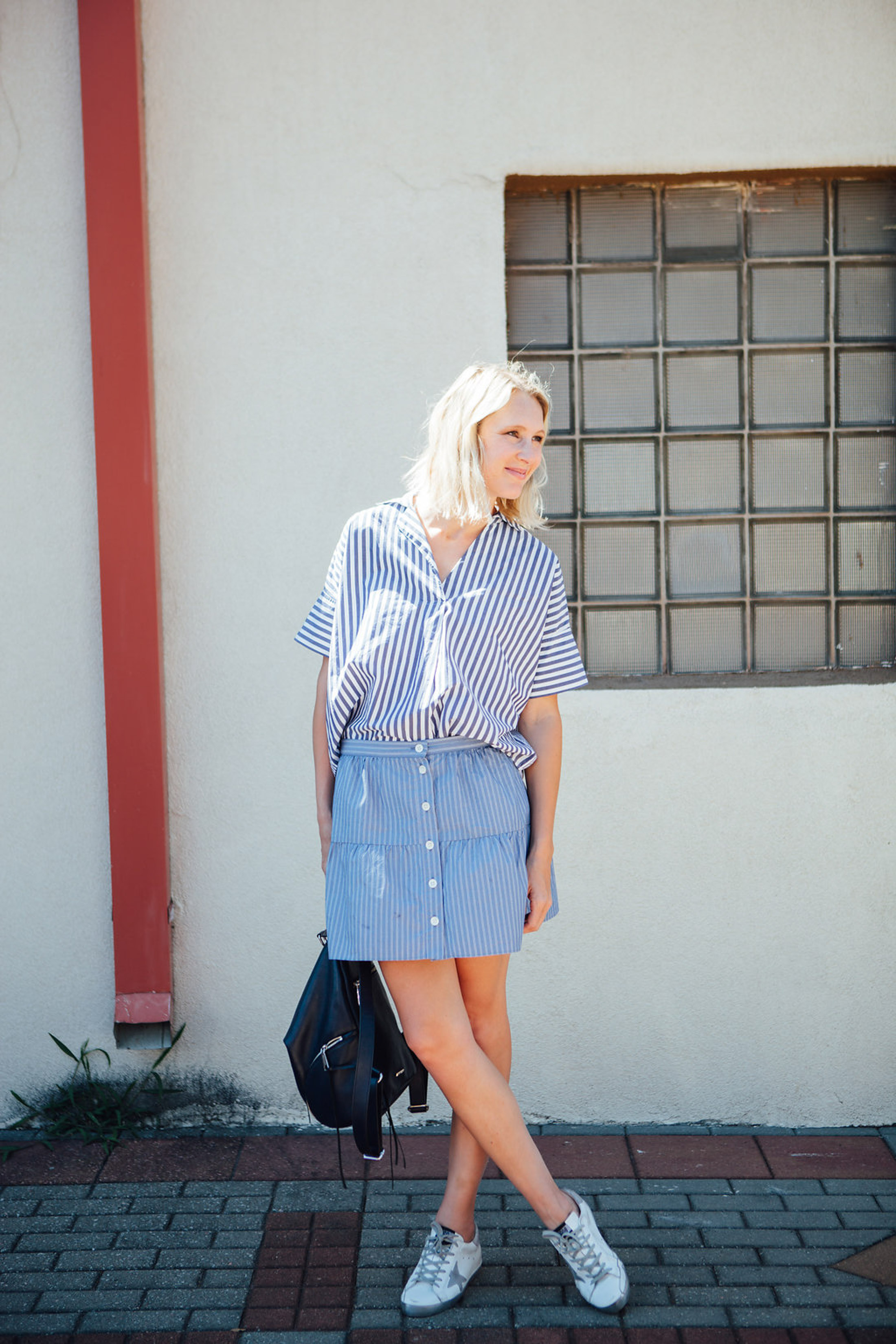 skirt with golden goose sneakers