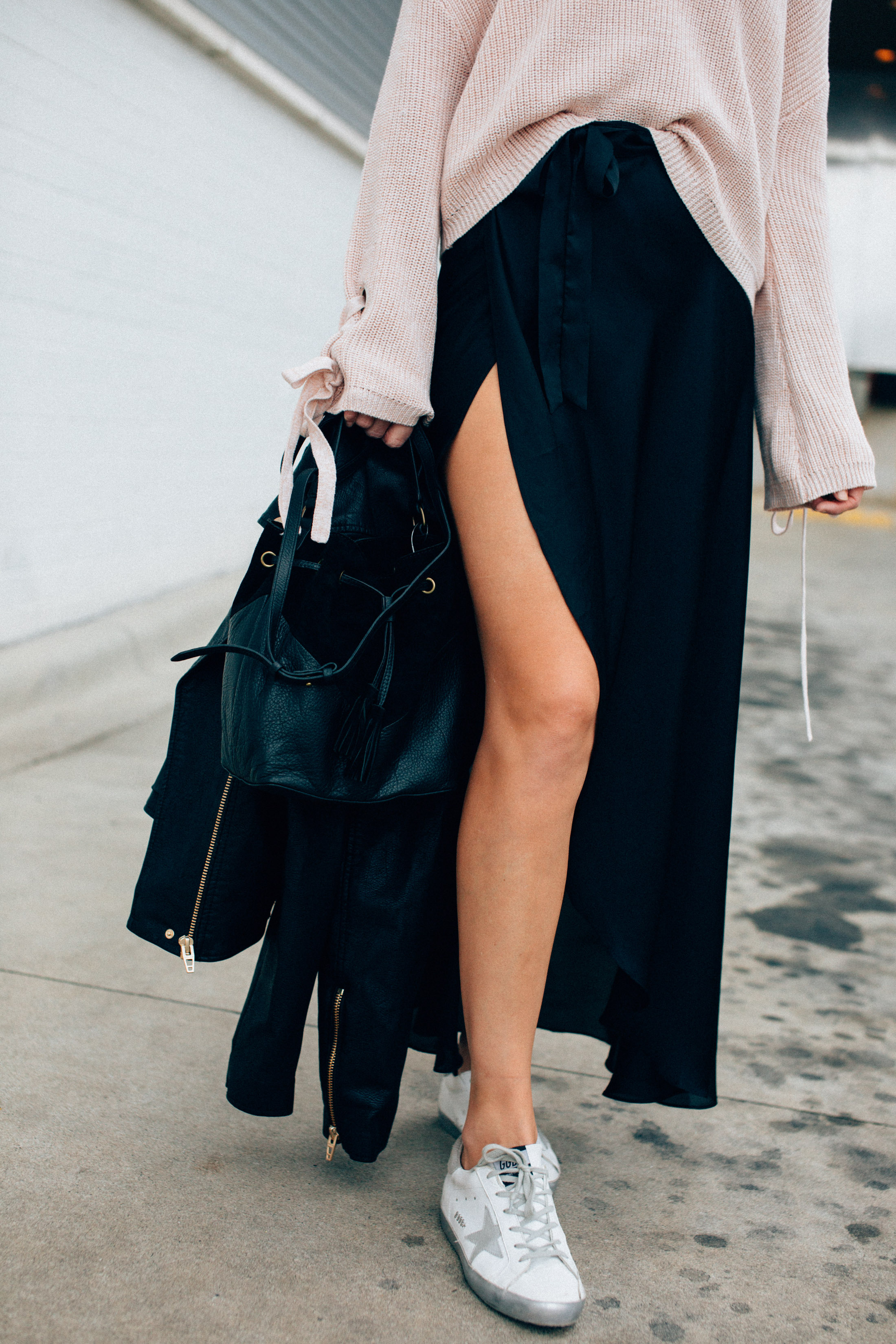 black wrap skirt with golden goose sneakers