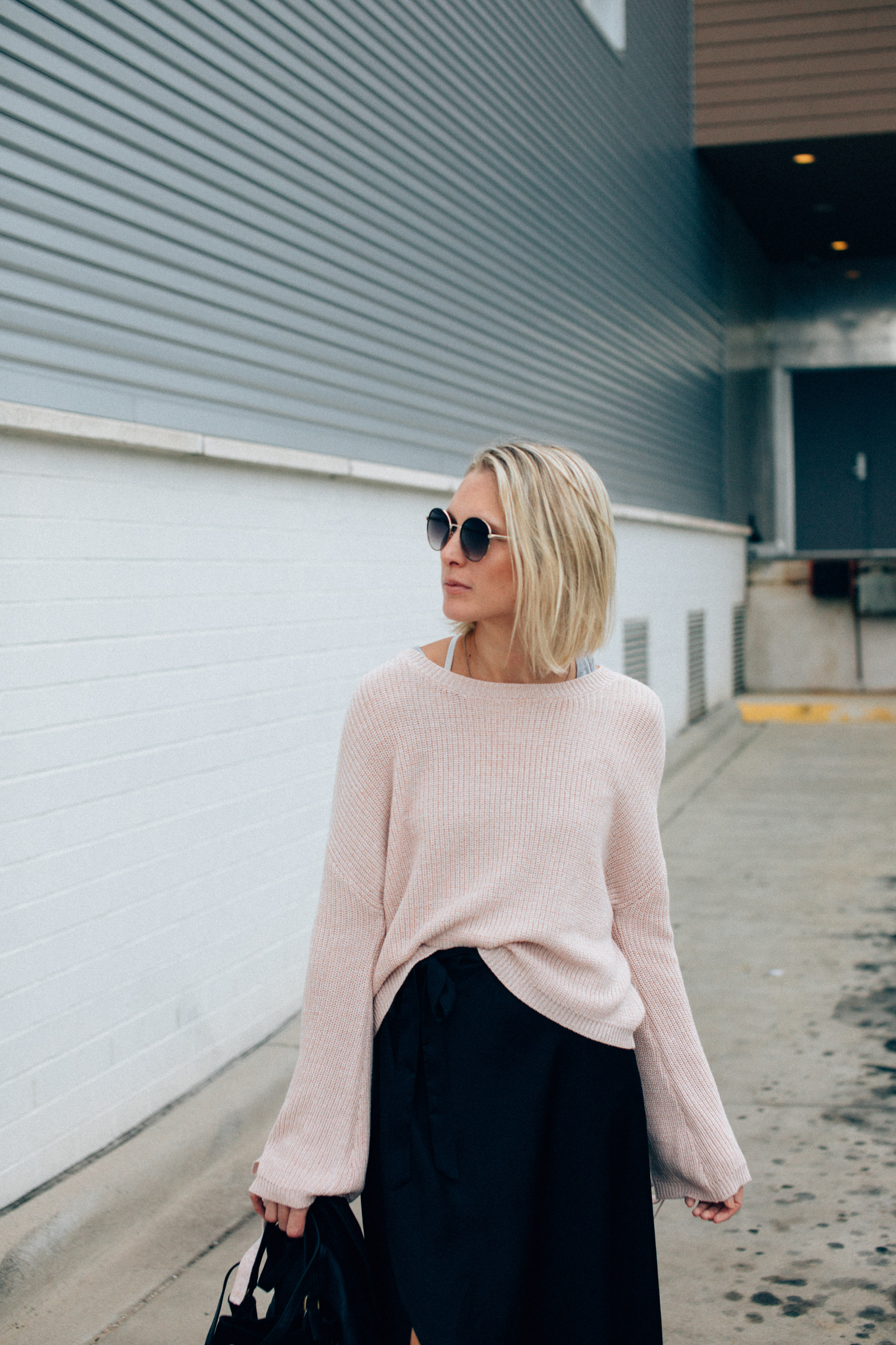 blush pink bell sleeved statement sweater