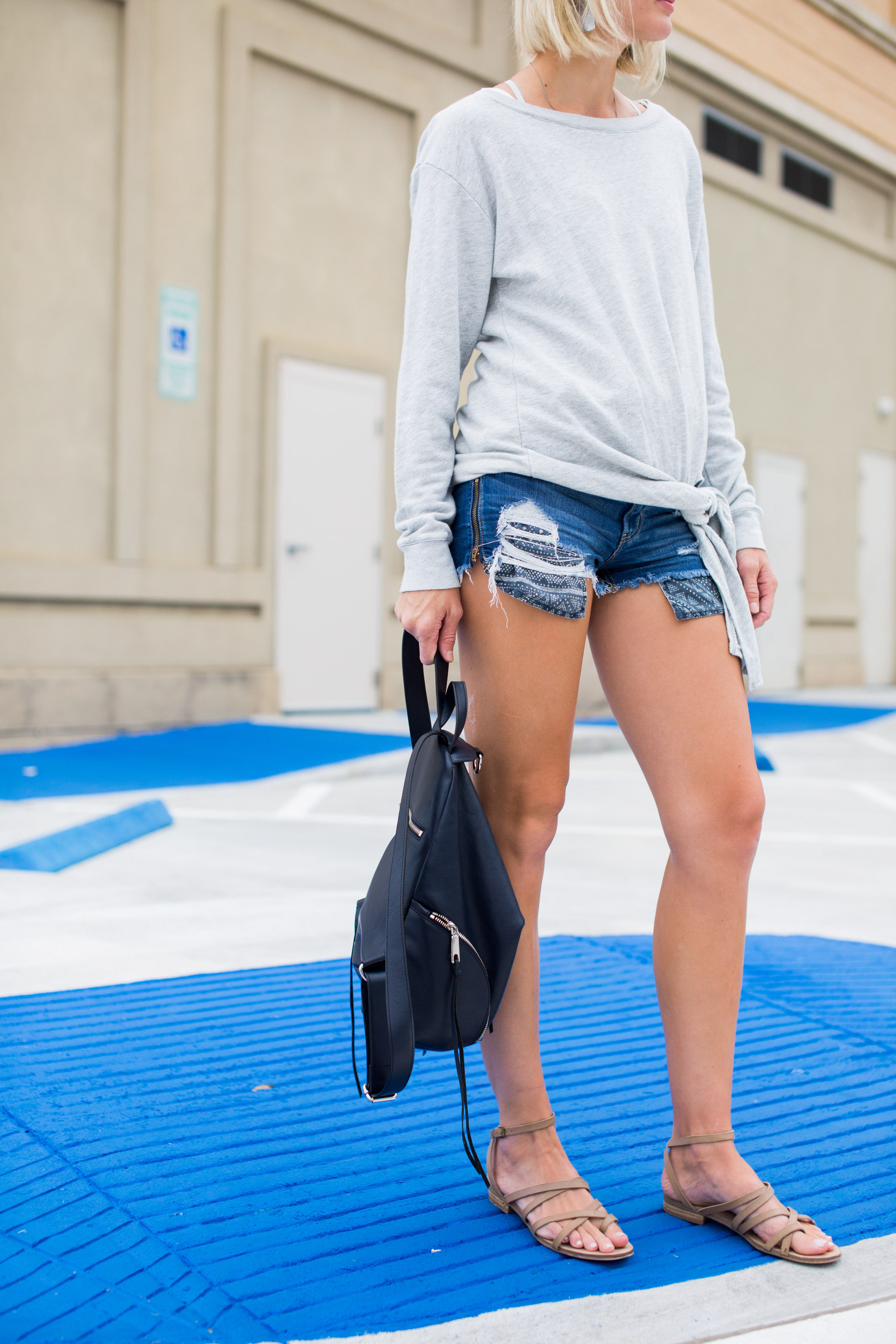 cut off shorts with grey pullover sweater