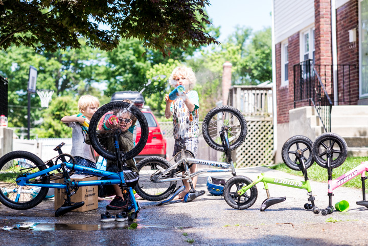 kids with water guns and bikes