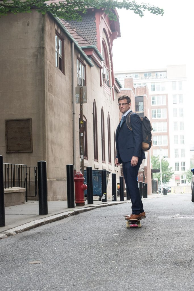 hugo-boss-suit-skateboarding