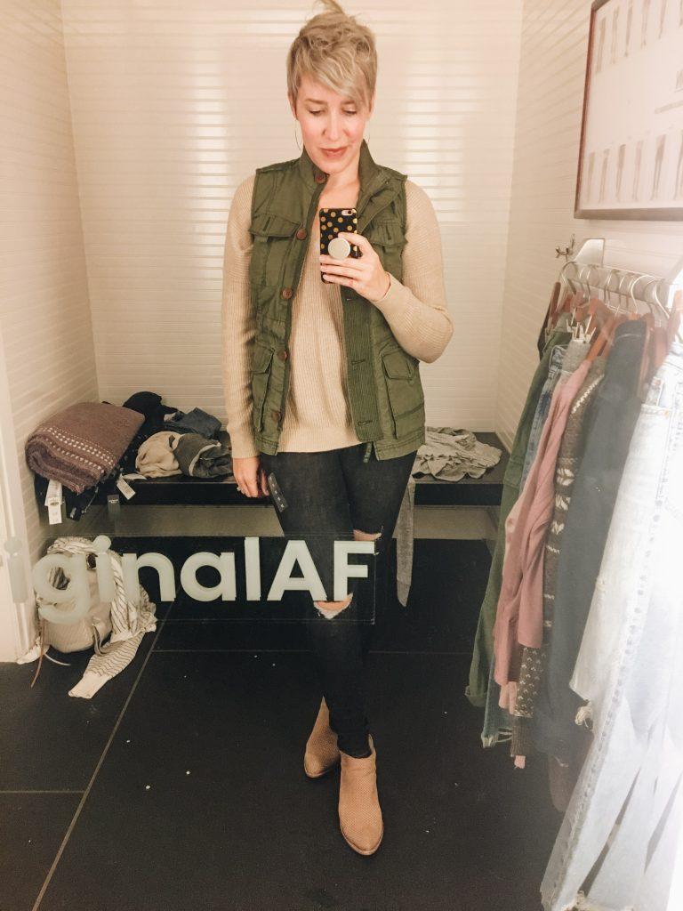 green vest camel sweater black skinny jeans