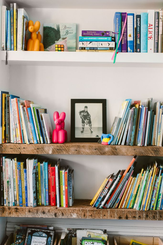 These are city kids. We created a playroom that gives 'em plenty of activities: (climb, swing, hang or fly,) plus Montessori-style organization.