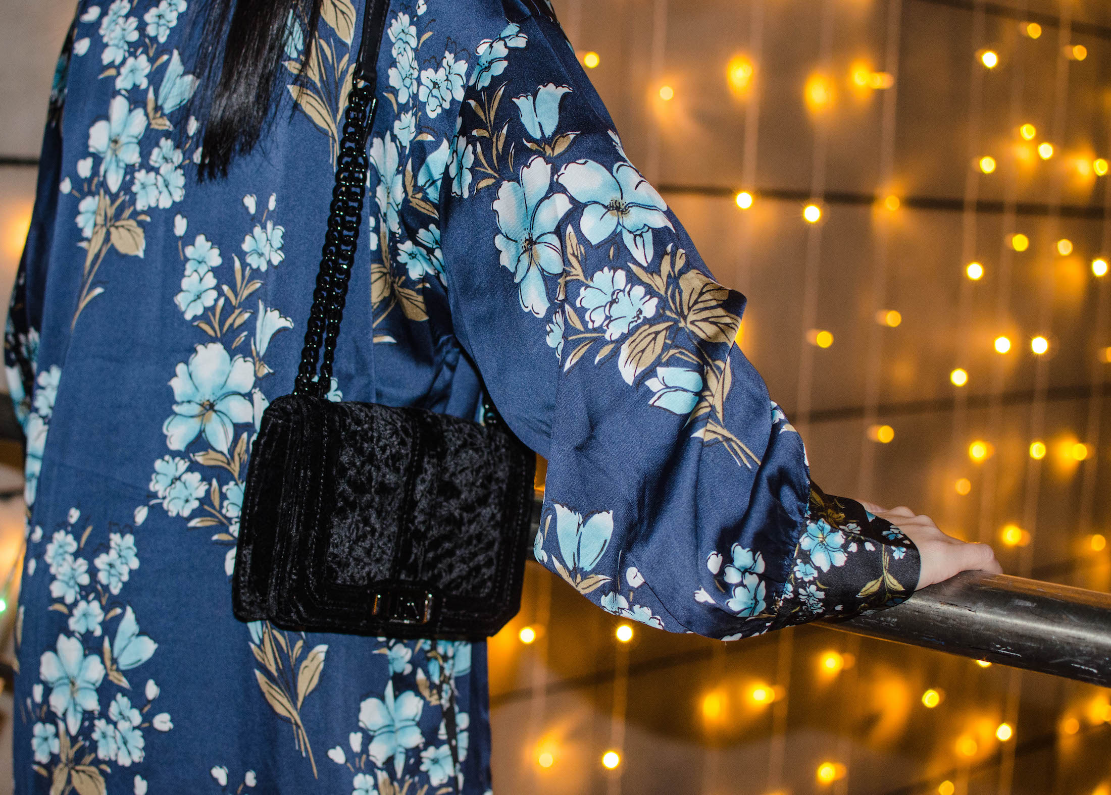 We're thinking of a great piece that makes a basic outfit not-so-basic. Any guesses? A KIMONO. Try this chic, easy piece this holiday.
