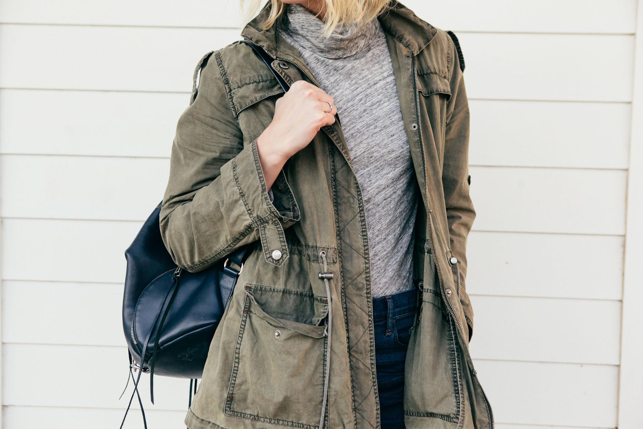 light grey turtleneck with green jacket
