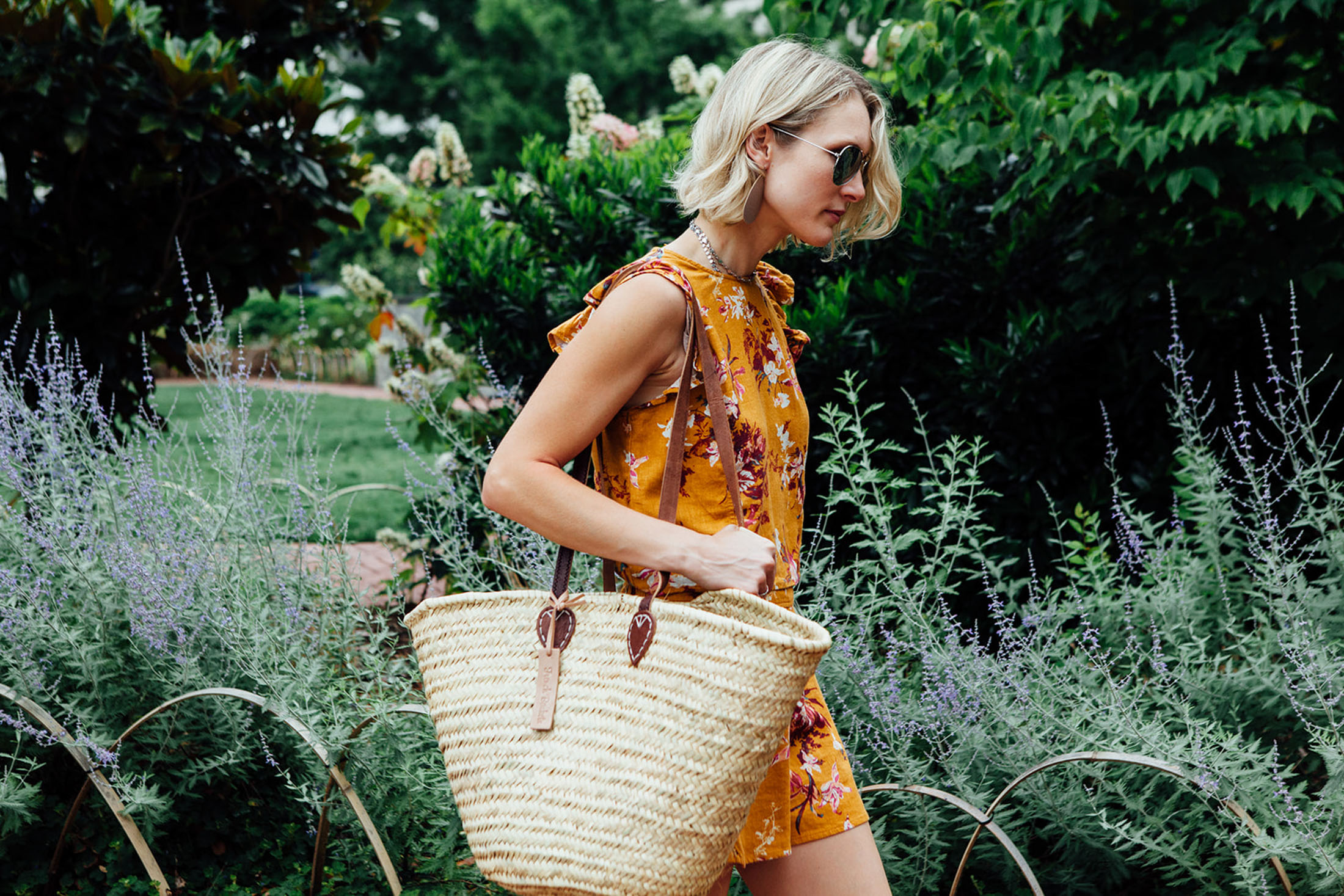 straw-tote-bag-floral-shorts-and-top