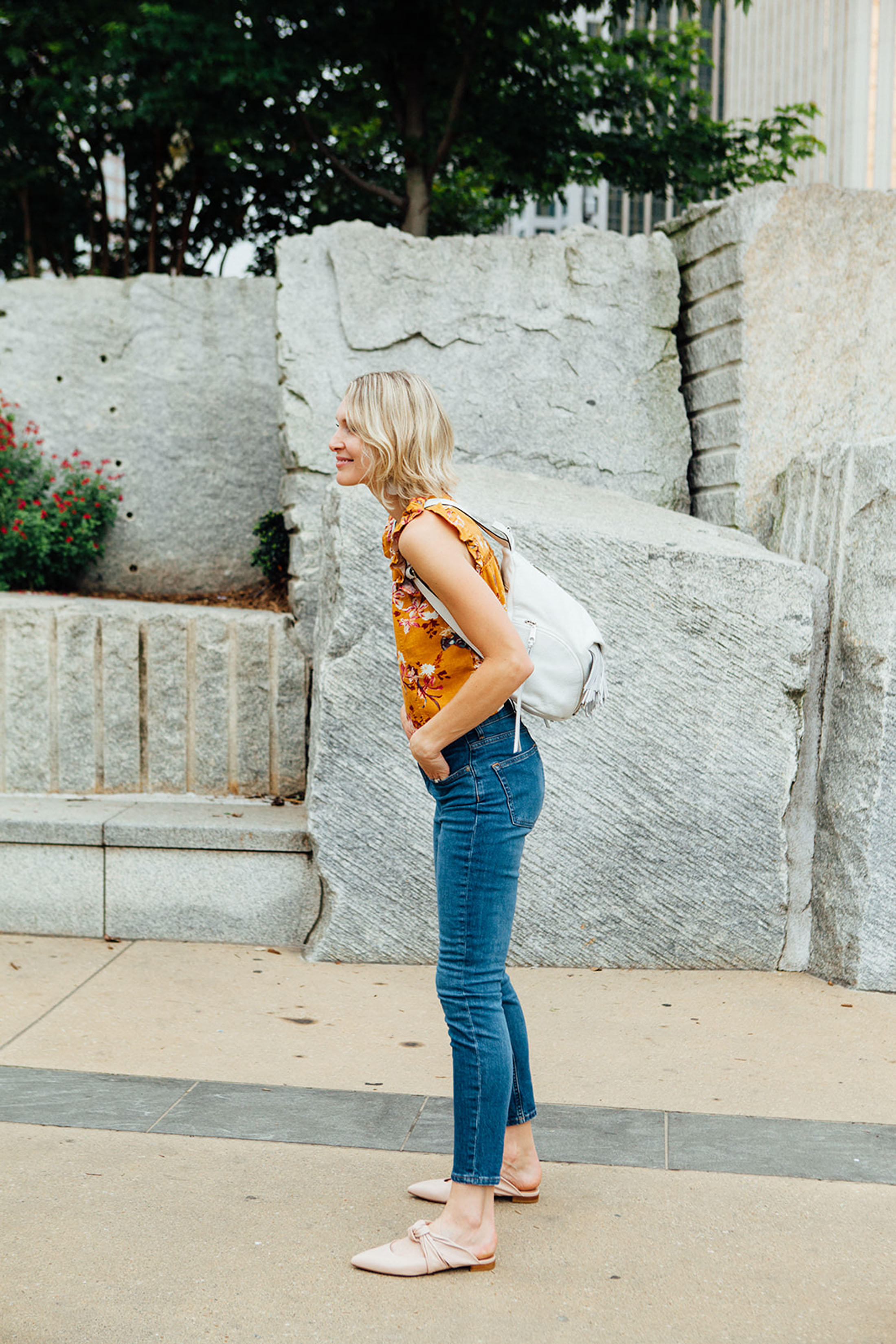 wearing cropped top with ankle jeans and mules