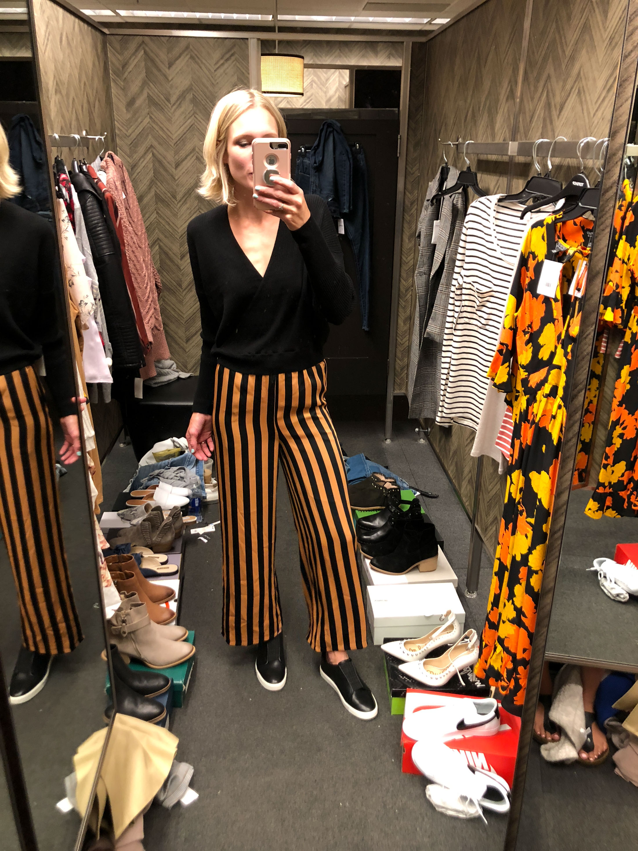 gold black striped cropped pant black wrap top and sneakers