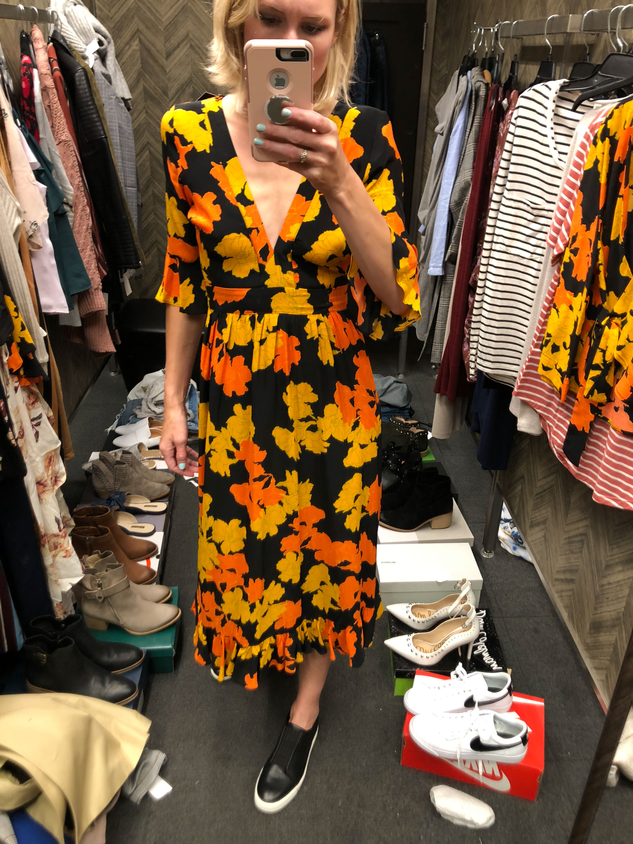 orange black yellow floral midi dress and black platform sneakers