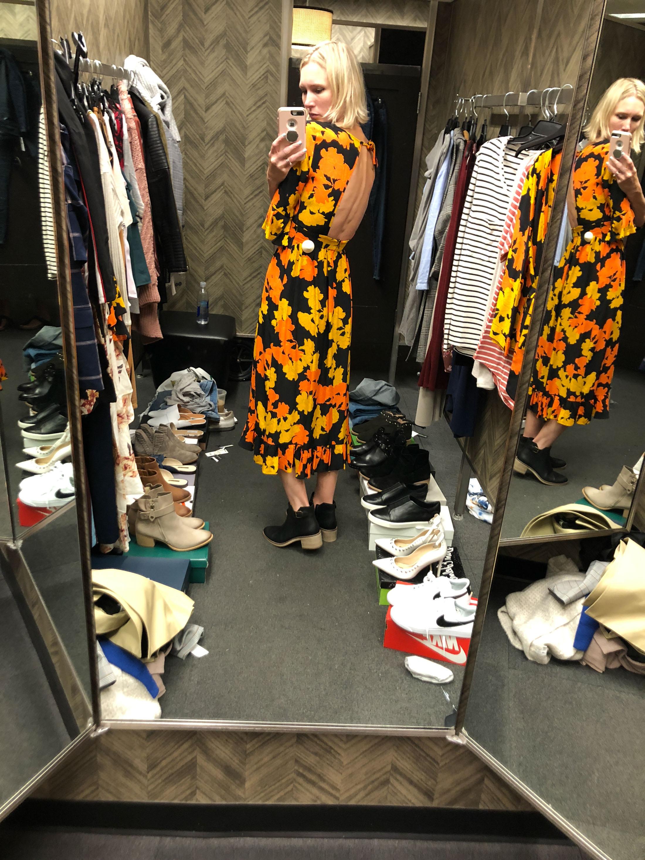 orange black yellow midi dress and black booties