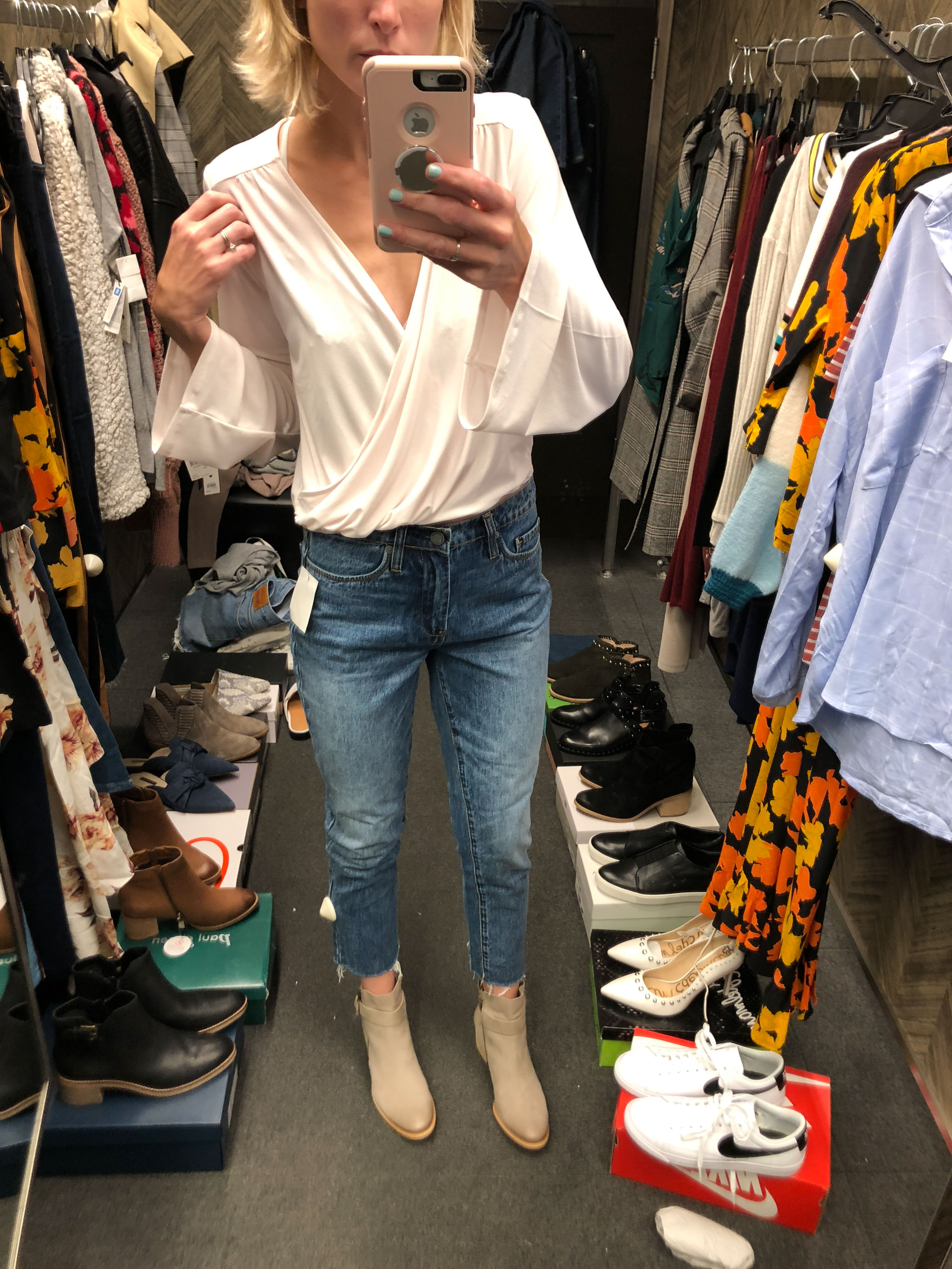 white wrapped bell sleeve top raw edge jeans booties