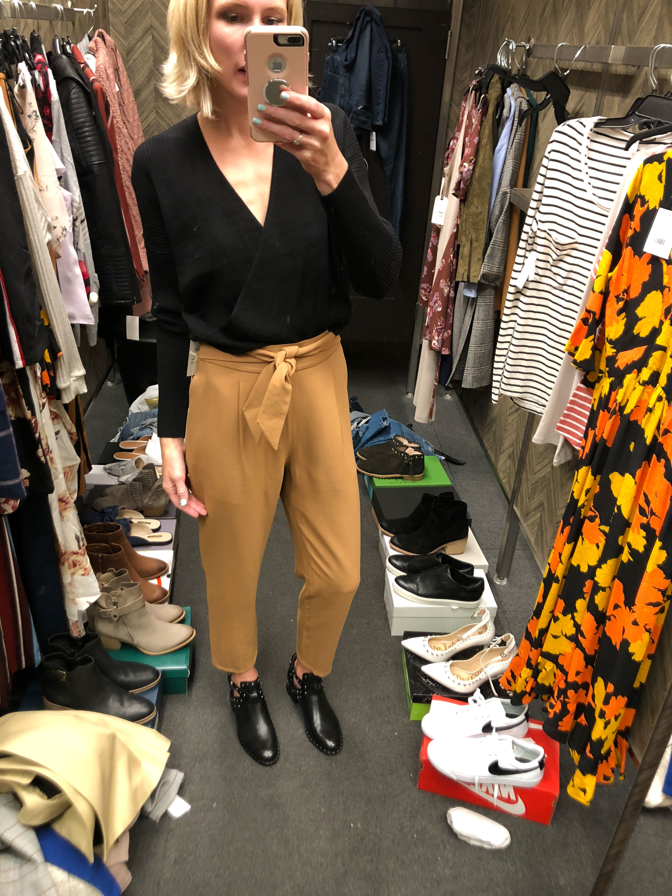 wrap black sweater top camel tie front trousers black studded booties