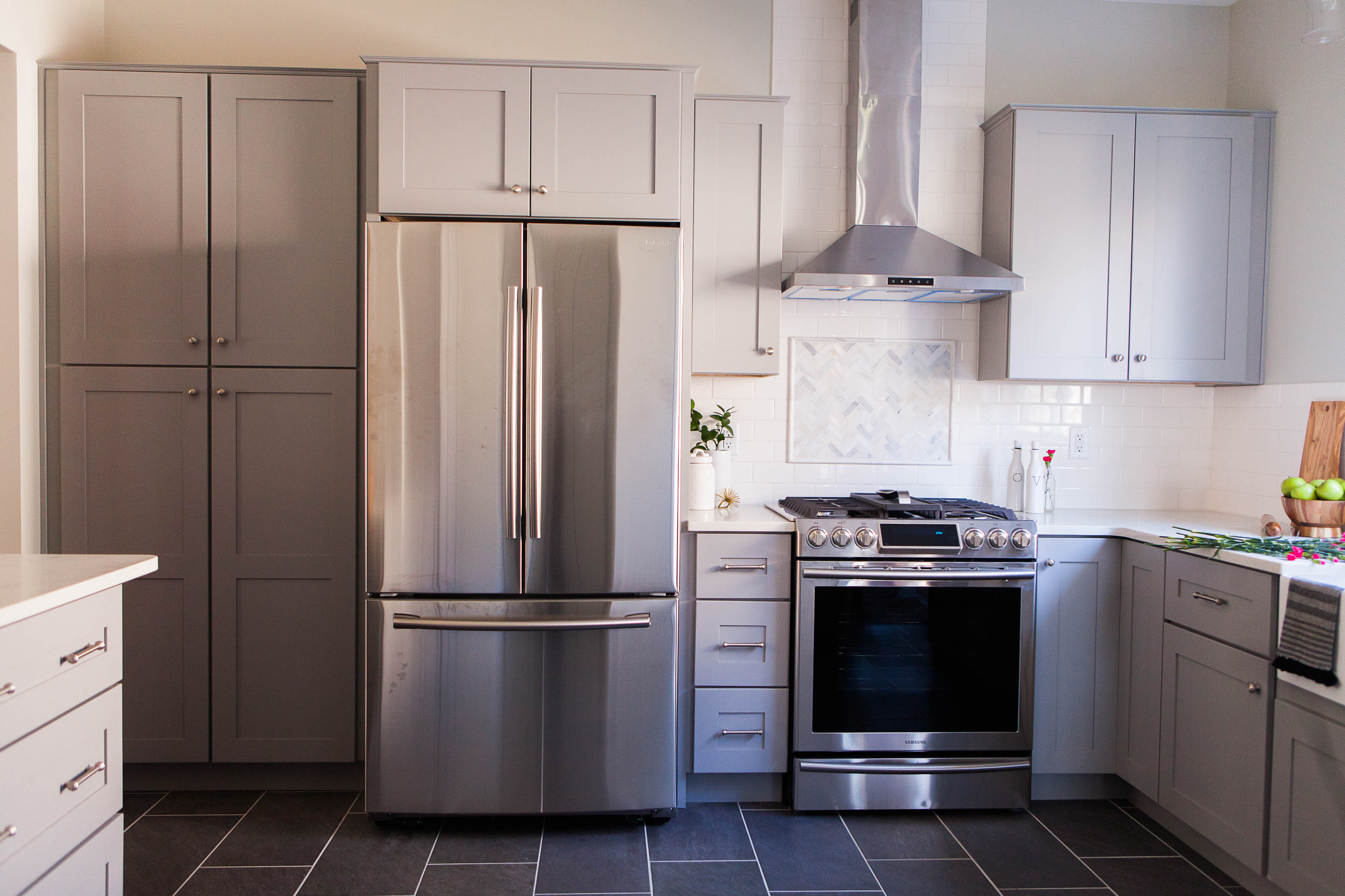 We LOVE a good kitchen remodel. But prioritizing function doesn't mean we sacrifice design. You'll drool over the cool gray & white upgrades in this space.