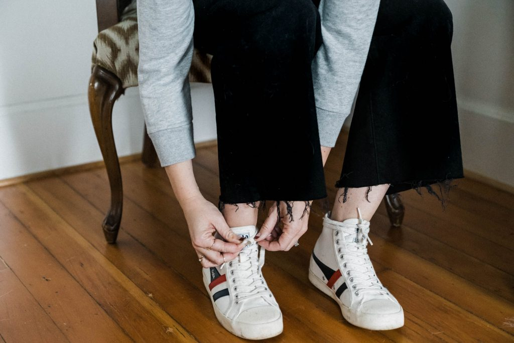Leggings, straight leg jeans, wide-leg cropped jeans & dress pants — can 1 high-top sneaker work with so many outfits? We say yes — here's our try-on sesh.