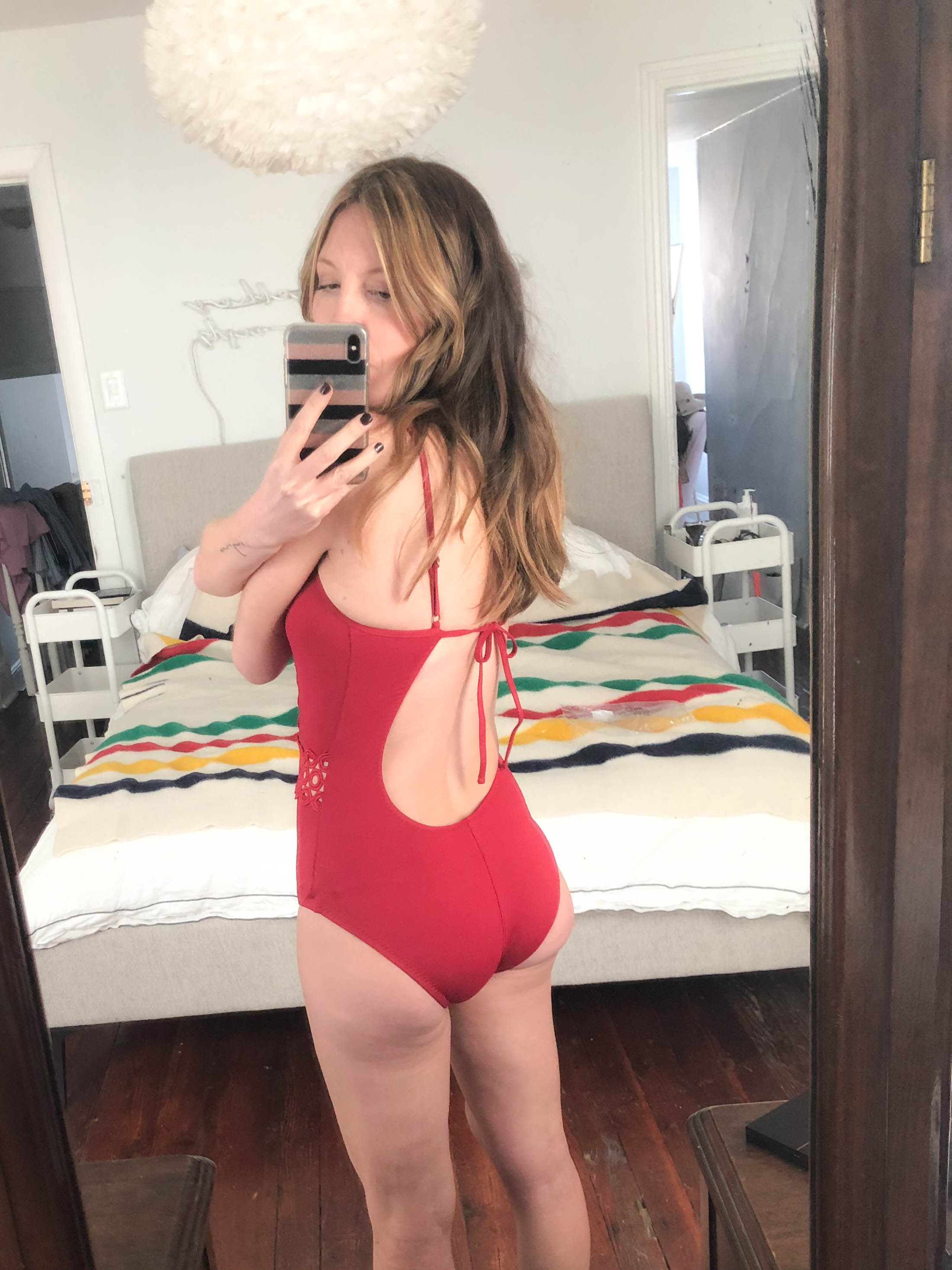 Crochet one-pieces, string bikinis & lingerie-inspired bathing suits — BECCA swimwear gets insanely rave reviews. This huge try-on sesh proves why.