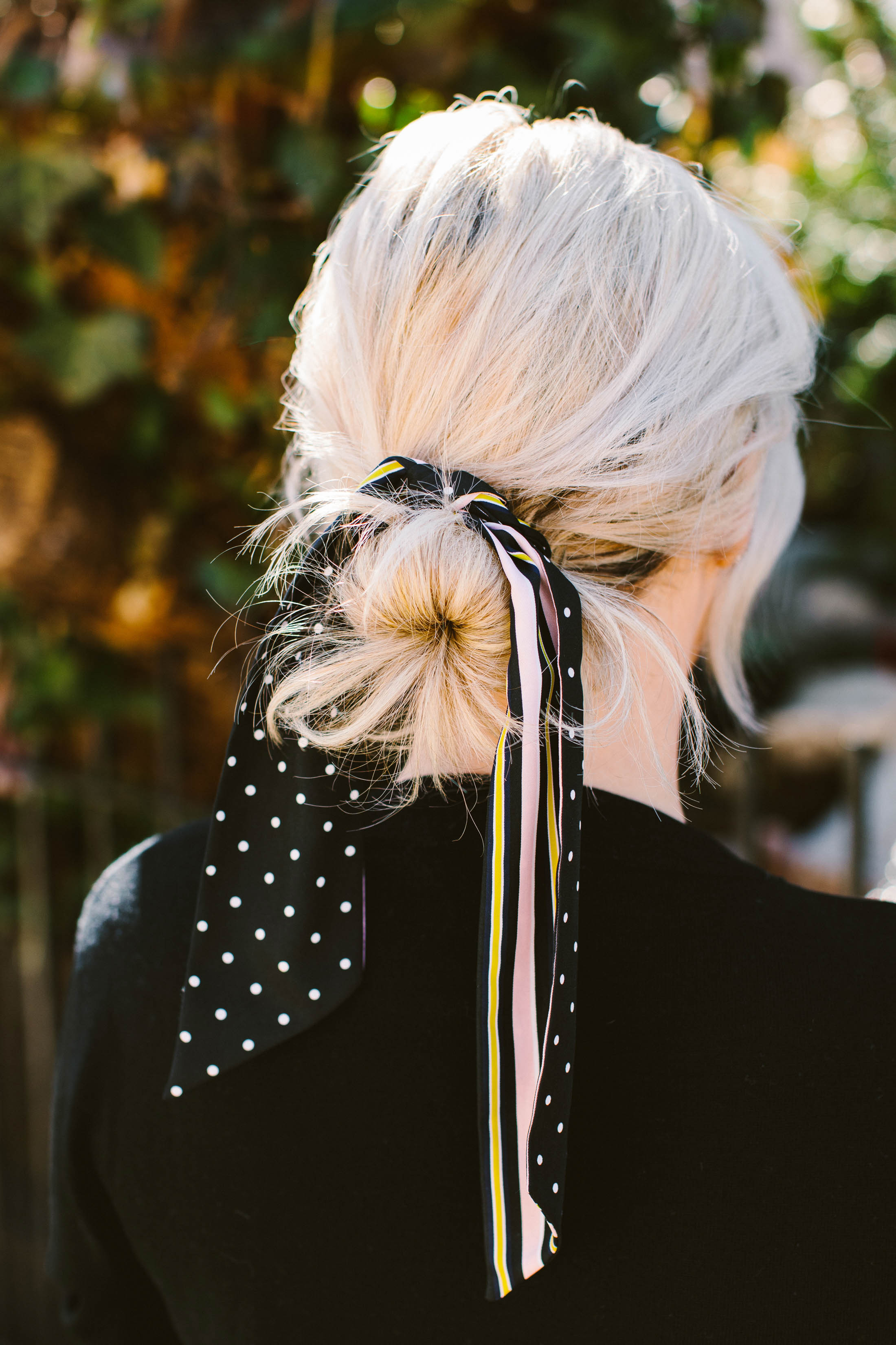 We're all about easy hairstyles...especially when effortless-but-chic. A silk scarf in your hair does the trick...ponytails, buns & next-day hair included.