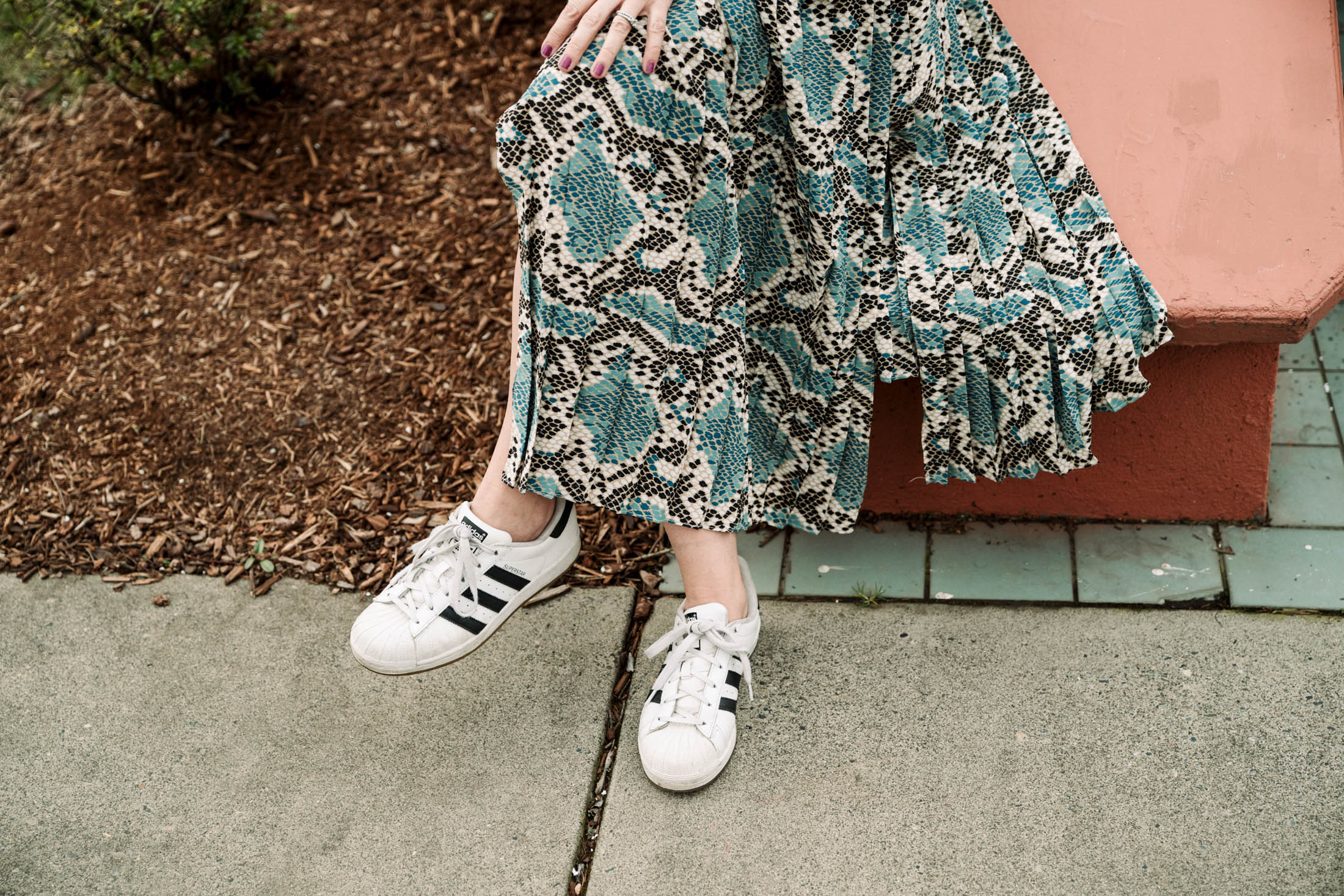 Take your pretty midi dress down a notch, from formal to casual, by pairing it with pieces uniquely you — a moto or sneaks, maybe? Do YOU. Here's how we do.