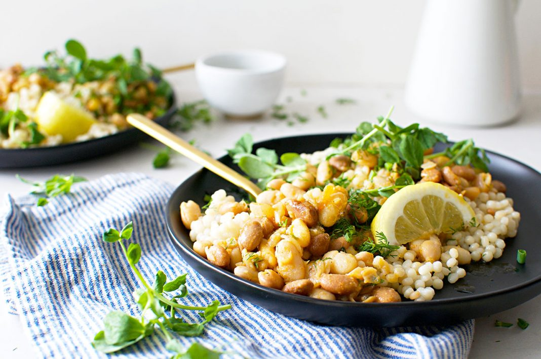 YUM — an easy weeknight vegan dinner recipe serving up a whole lot of flavor that's healthy — we're in! Check out these garlicky white beans & couscous.