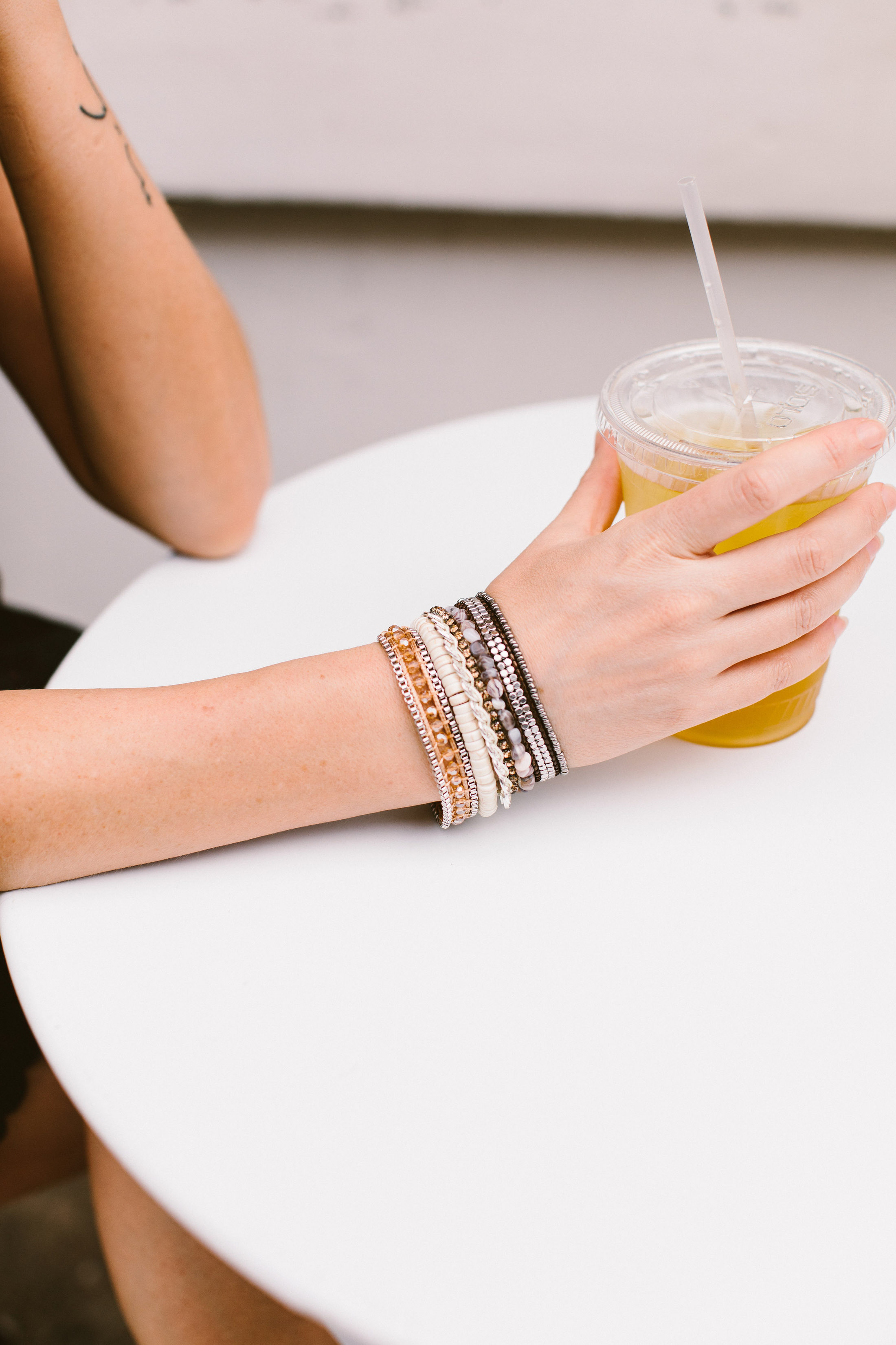 It's Summertime! We're breaking out the Victoria Emerson wrap bracelets — the perfect accessory for beach & vacation travel outfits. Wear 'em like this...