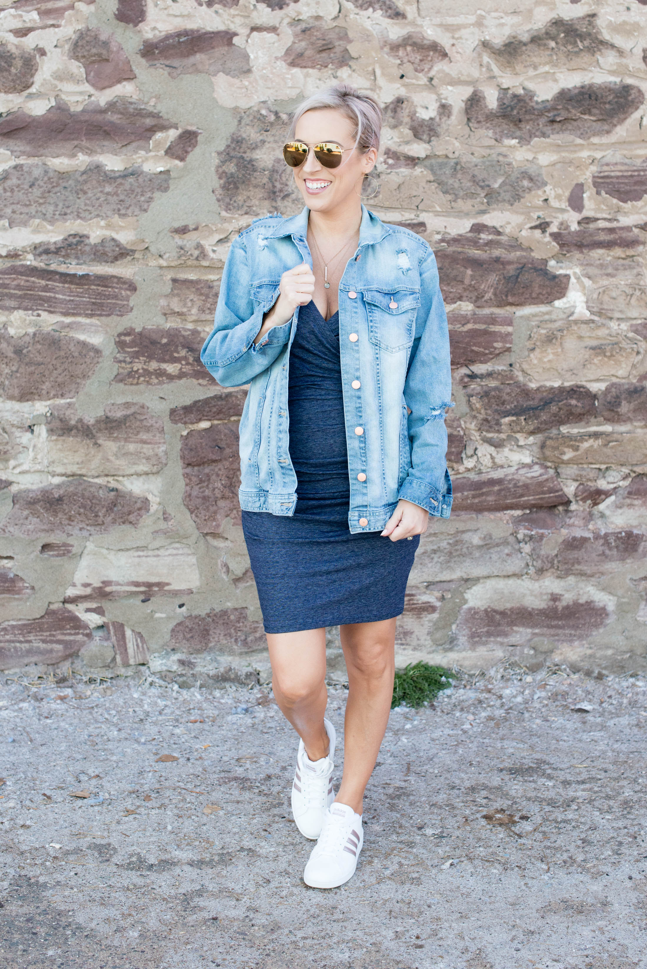 Comfy t-shirt dress + oversized denim jacket + cute white sneaks = easy summer outfit formula done. Check out this effortless daily style.