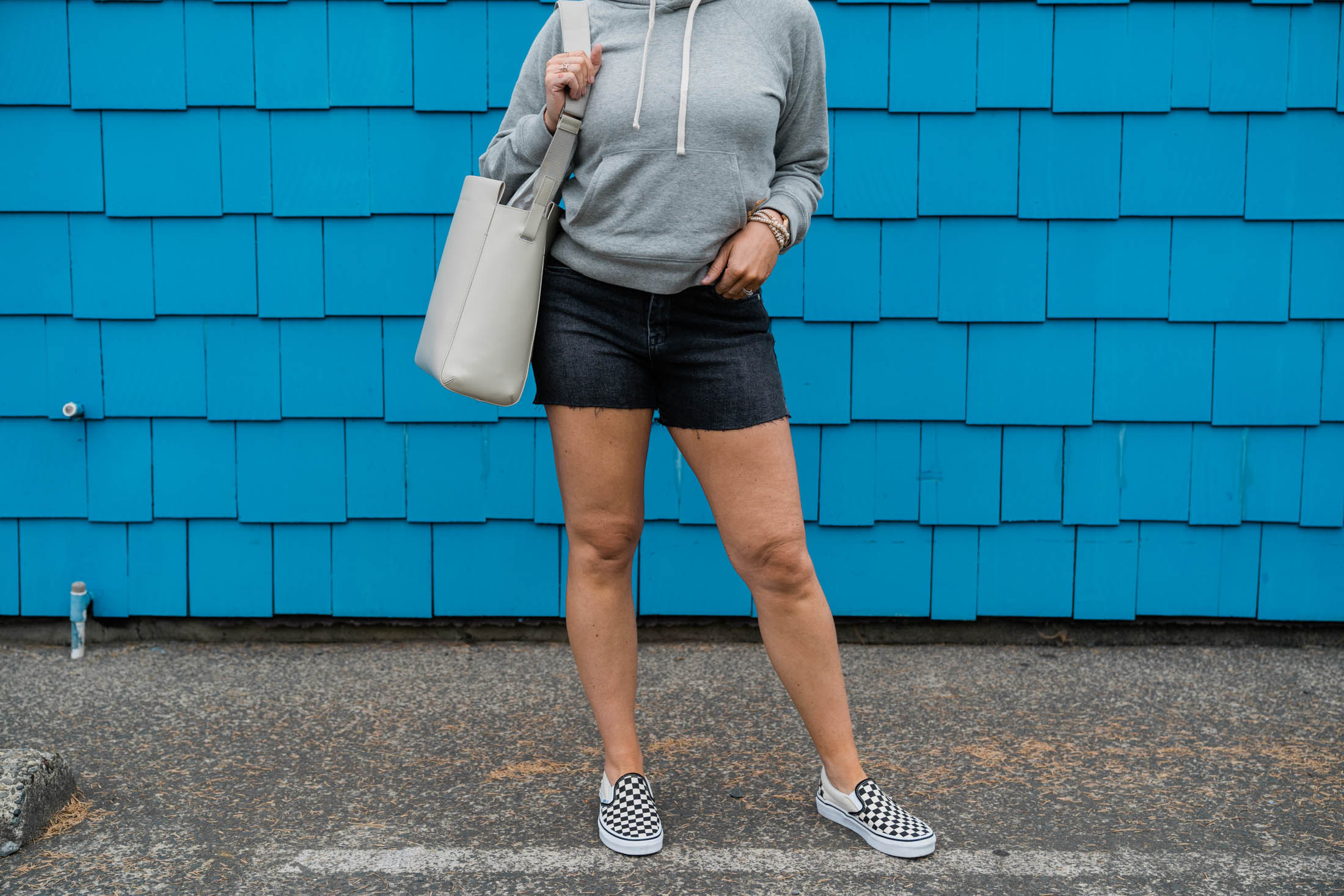Like a solid '90s throwback, TME is all over Classic Vans Slip-ons...again. All the heart eyes for black & white checkerboard sneakers...a summer fave.