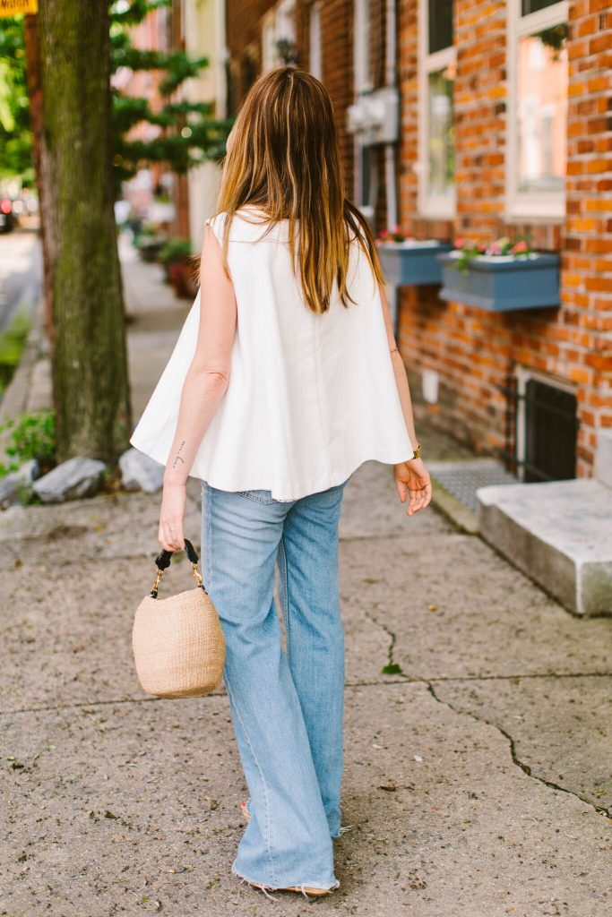 We love a pretty white top — a flirty, feminine counterpart to a pair of jeans. A riff on that classic combo is to add drama with sculptural white tops.