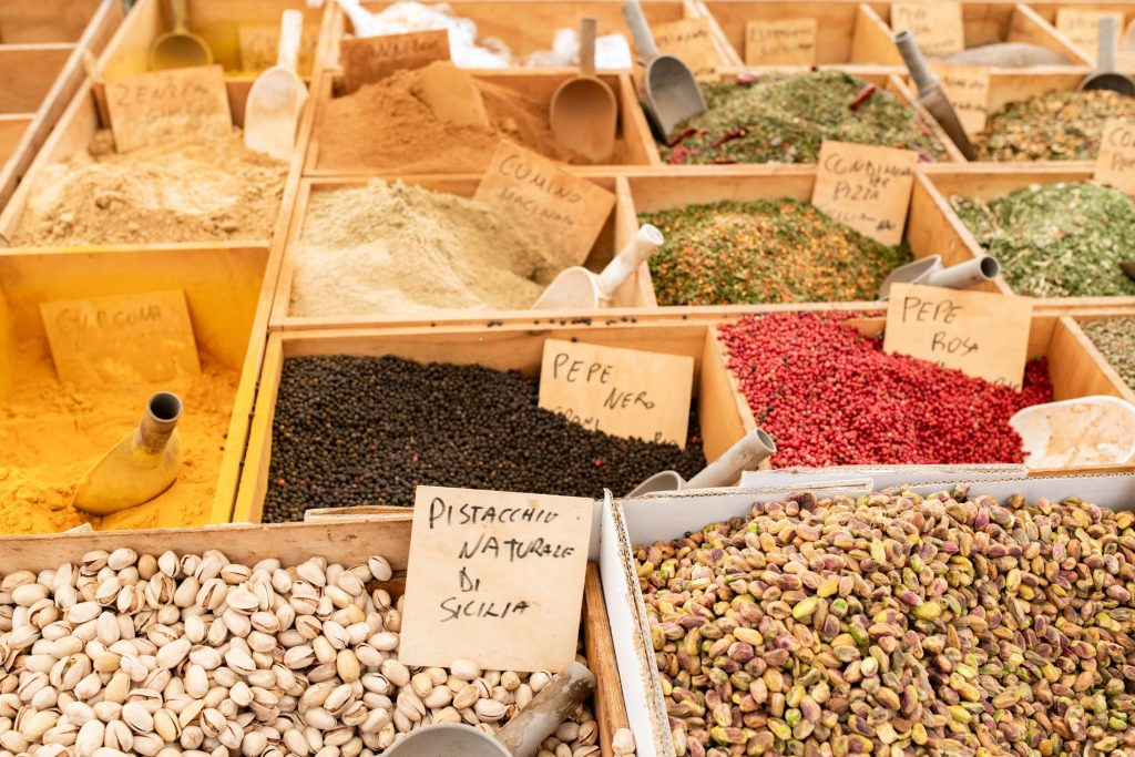 The food markets in Ortigia, Sicily are to die for! Family-friendly + offering nuts & dried fruits, charcuterie boards, Sicilian wine & other goodness. YUM!