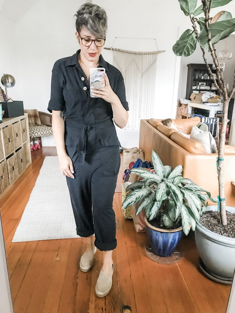 Found: a swoon-worthy black utility jumpsuit from Free People. We're styling this comfy romper 8 ways: animal print, belt bags, Doc Martens & sneakers. #WIN
