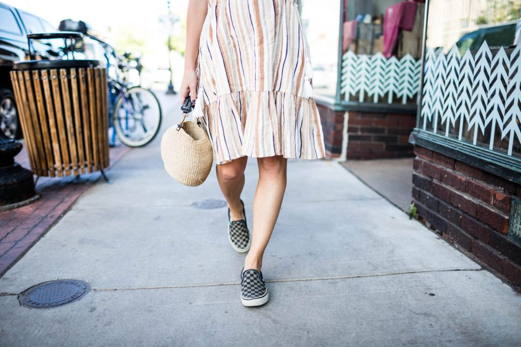 Sneakers with dresses. YASSSS. We've found an outfit combo that's comfy, cute & chic, plus perfect for momming. Heart eyes. Happy feet. (& a straw bag).
