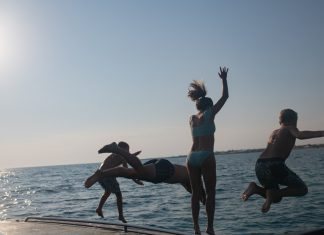 We chartered a pretty epic speedboat in Syracuse, Ortigia in Sicily. Our boat excursion included swimming to a restaurant —perfect family-friendly day.