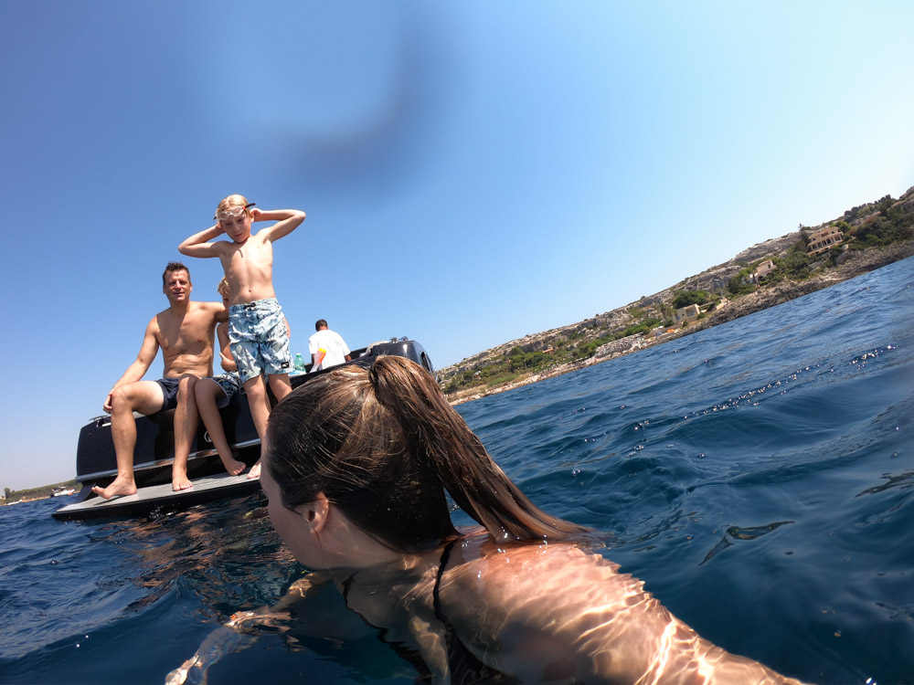 We chartered a pretty epic speedboat in Syracuse, Ortigia in Sicily. Our boat excursion included swimming to a restaurant — perfect family-friendly day.