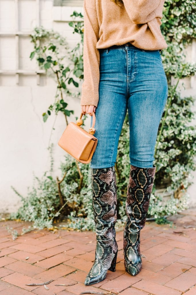 A go-to party outfit (dare we say uniform) is always good to have on hand — especially for fall & holiday season. Tall animal print boots, jeans, sweater...GO!