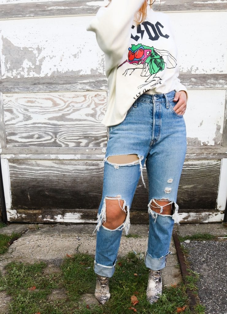 Snake print, denim & rock 'n' roll, baby. Inspo for your fall outfits, streetstyle aesthetic ideas. Graphic sweatshirts. Distressed Jeans. Snakeskin booties. Uniform done.