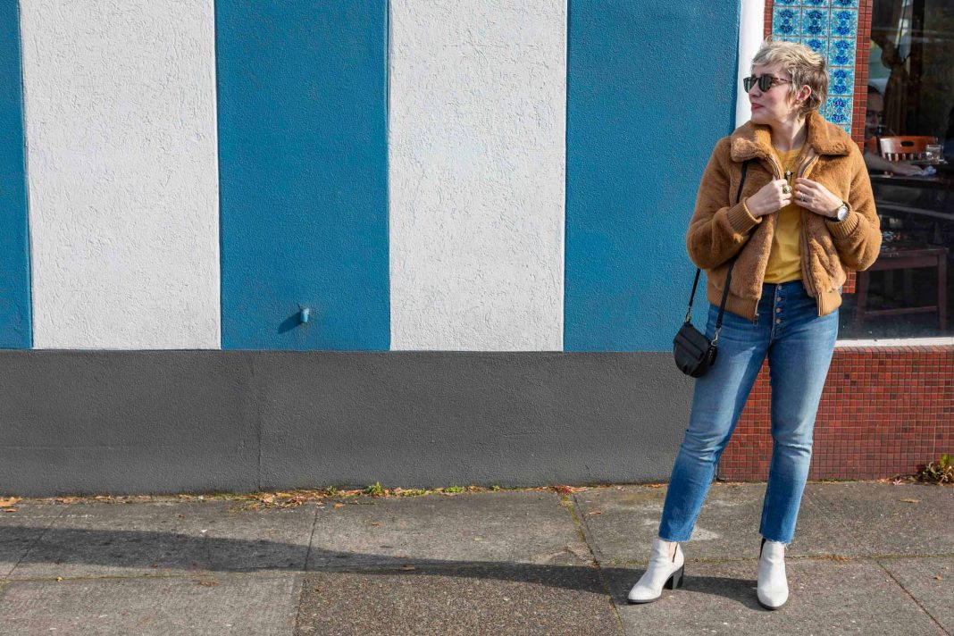 Cold, dark weather calls for an outfit combo we're calling happy vibes: think totes sunny & warm. Pairing a warm camel teddy coat w/ a warm yellow tee? YES.
