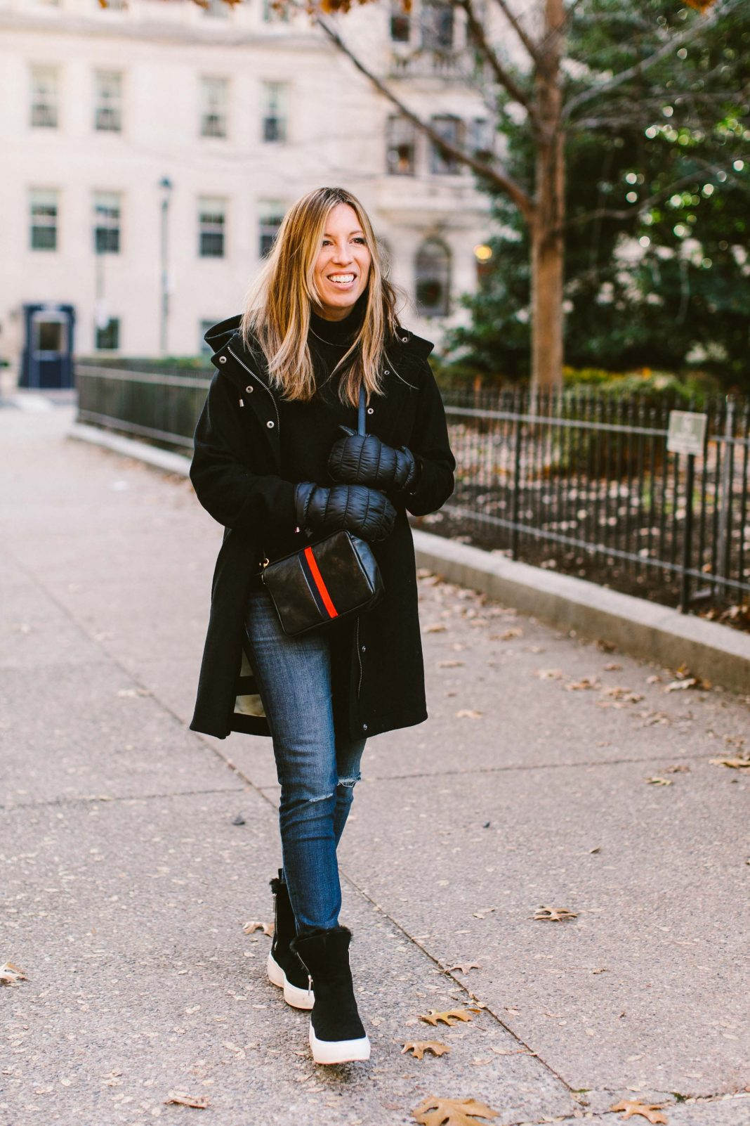 We have a winter uniform of sorts, perfect for day & date night. The jeans, boots & bag get tweaked, but the sweater? Always a black cashmere turtleneck.