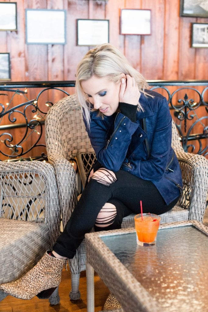 """A winter outfit """"twist"""" on my tried-&-true favorite of black-on-black? Add a colorful suede moto jacket (instead of a cardigan) + leopard print booties."""