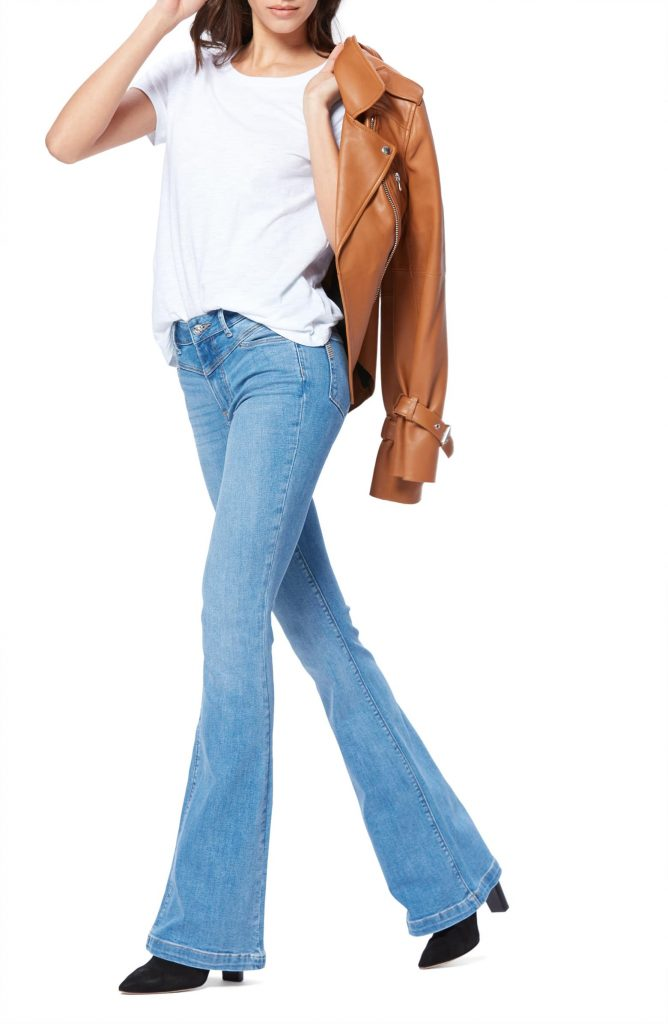 Those new jeans —the 1s w/ the v-shape accentuating a high waist? They're front yoke...a retro trend we're kinda lovin' right now. Here are 4 ways to style 'em.