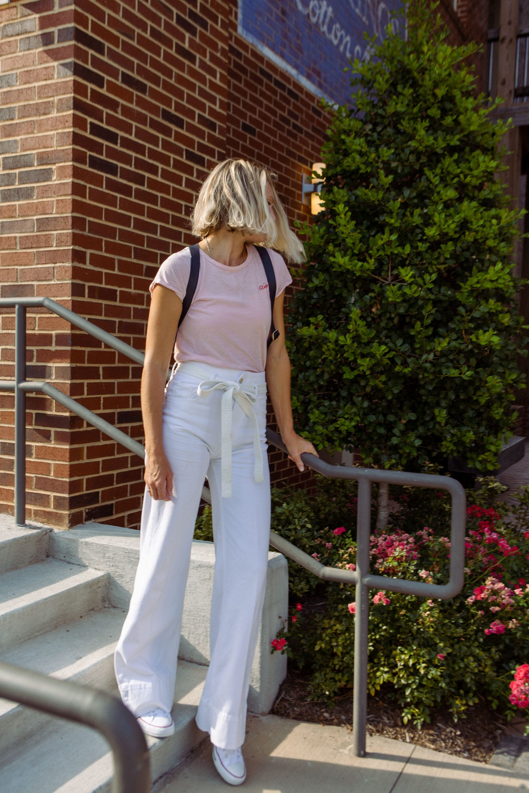 The white DL1961 high-waist, wide-leg jeans are SO GOOD, we're styling 'em for summer & fall. Camis, motos & sweaters...7 cute outfit ideas.