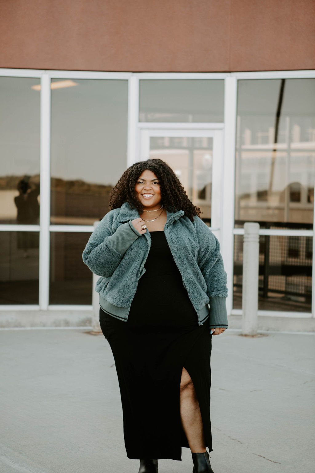 The Athleta Tugga Sherpa Jacket comes in 3 gorg colors & is available in plus-size, petite & tall. We're styling it w/ Levi's -- & a Reformation dress.