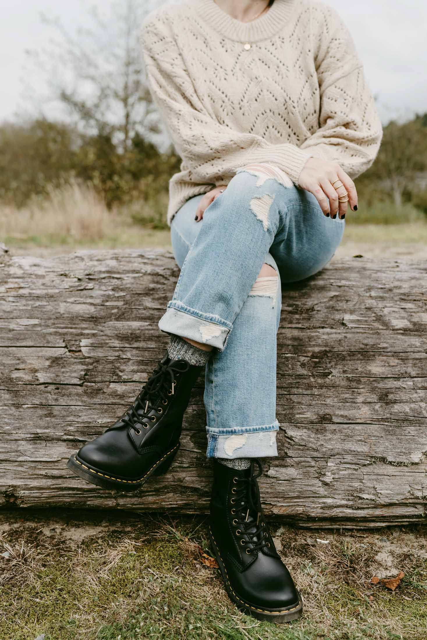 Dr. Martens continue to be a TME fave for combat boots. We're styling 'em w/ straight-leg crop jeans & black-wash dad jeans. 2 outfits — inside.