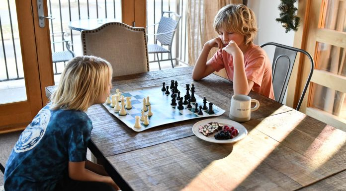 Obvi our kids were going to learn how to play chess. We're not trying to raise grandmasters; we think chess is a life skill. From the best chess boards to apps & books: our 5 tips.