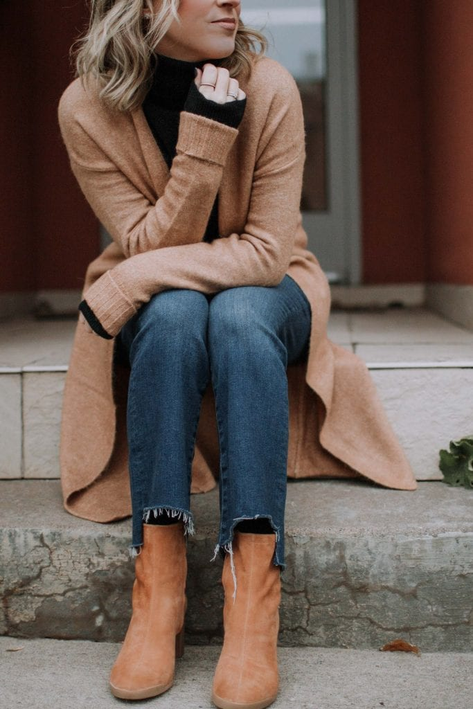 How to wear cropped jeans in winter? It's all about the boots or booties. Throw on a black cashmere turtleneck; layer it up; problem solved. Outfits styled, inside.