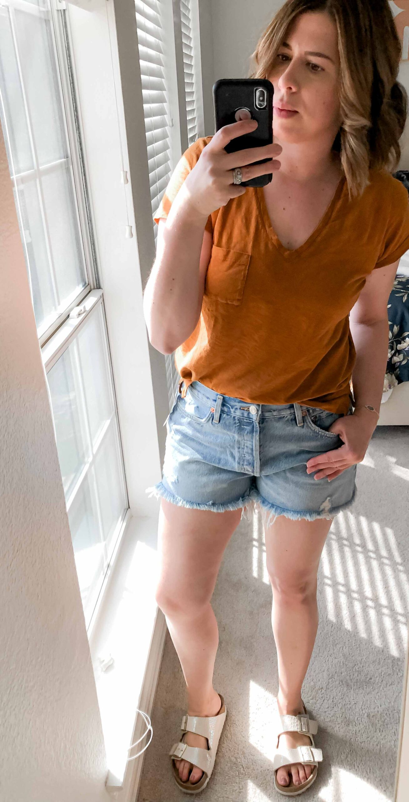 """""""Who in their right mind tries on 9 pairs of jean shorts, 9 months after having a baby during a pandemic?"""" The Mom Edit, that's who. All the deets of the try-on sesh, inside."""
