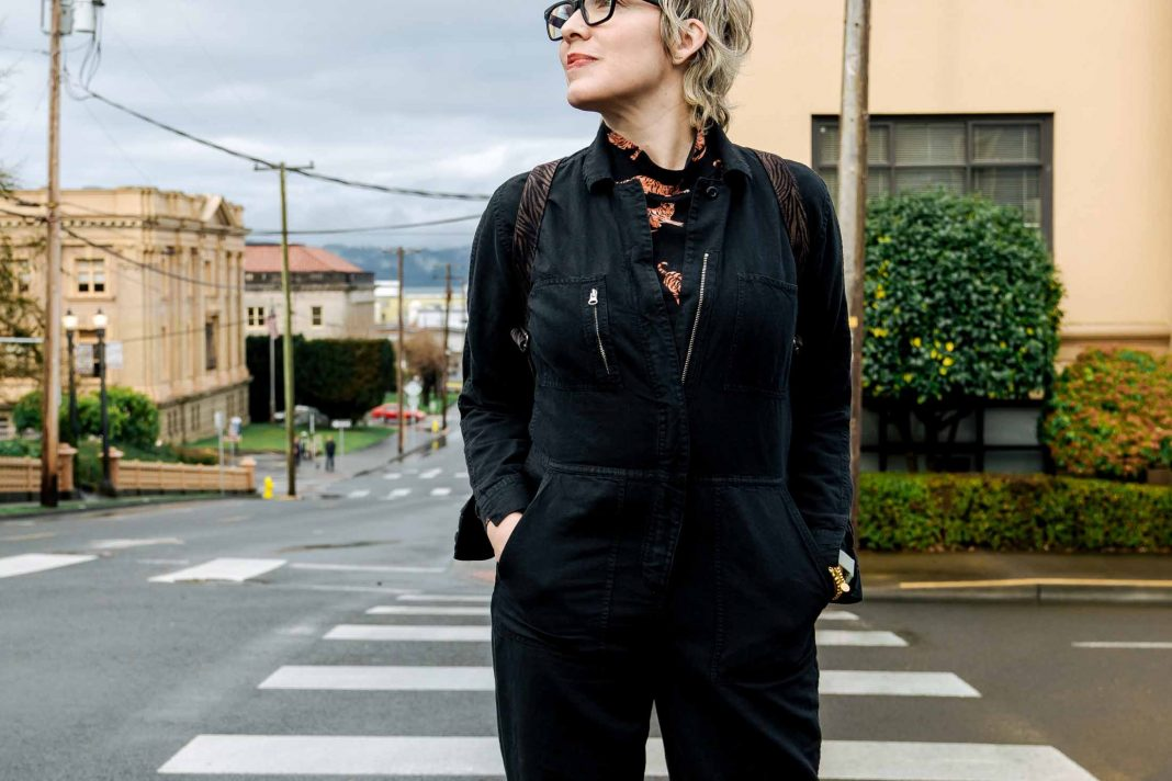My longtime black coveralls are sustainably made, super-comfy & 1 of my fav jumpsuits in my closet. Styling it 3 ways from my wardrobe.