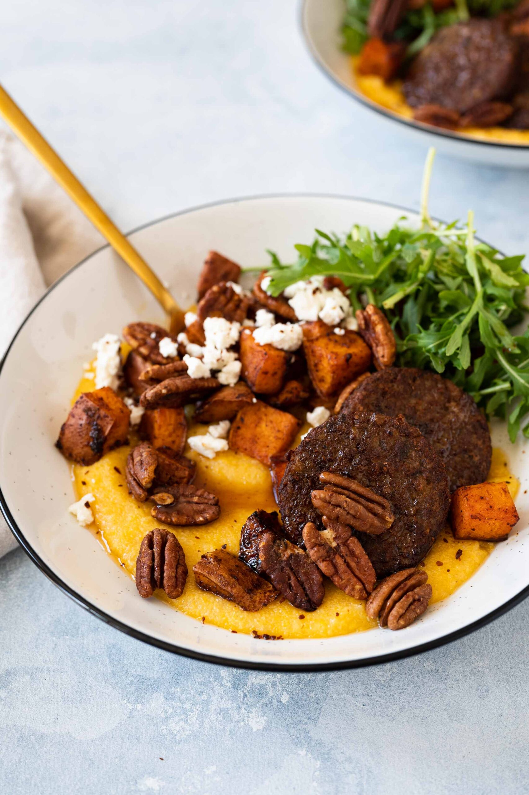"This easy sheet pan meal featuring grits, sweet potatoes & ""sausage"" is hearty, vegan + gluten-free. It comes together with very little hands-on time."